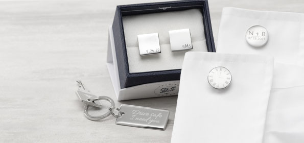 engraved men's accessories on table